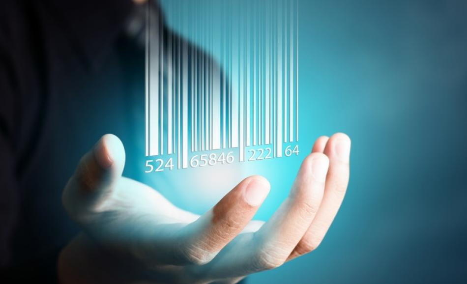 ©CanStockPhoto  ShutterM Barcode dropping on businessman hand