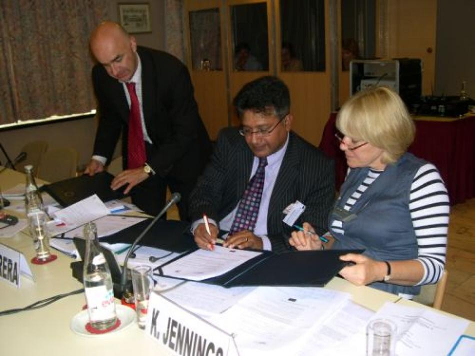 Mr François Ziegler presents the documents for signature to Mr Godfrey Perera, HOSPEEM Secretary General and Ms Karen Jennings (UNISON, UK) EPSU Standing Committee on Health and Social Services President