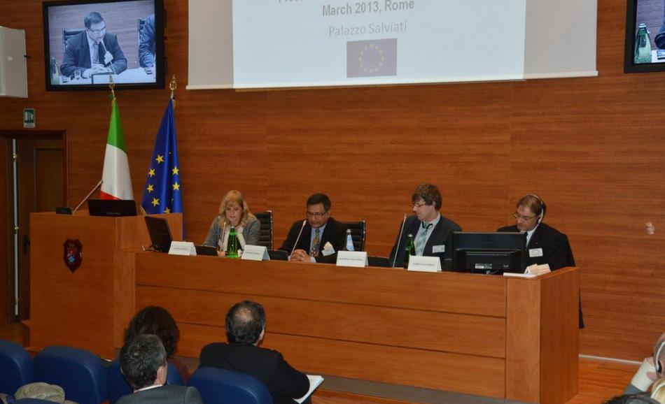 "Elvira Gentile (ARAN, Director General Collective Bargaining), Godfrey Perera (HOSPEEM, Chief Executive), Mathias Maucher (EPSU, Policy Officer ""Health and Social Services""), Marco Lo Verso (FP-CGIL, Responsible ""Health Care"") [from left to right] during the opening plenary session}"