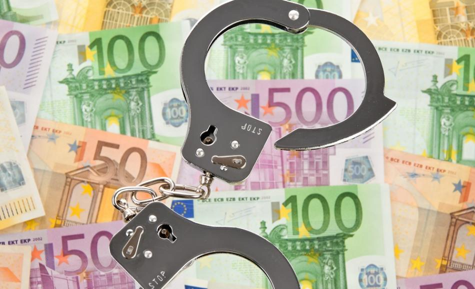 Euro bank notes with handcuffs symbol of collar crime Can Stock Photo Gina Sanders